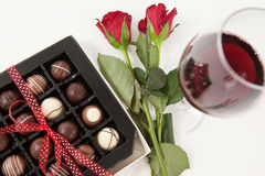 Bunch of roses, champagne bottle, wine glass and assorted chocolate box Stock Photo