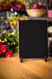 Bunch of roses and digital tablet on the wooden table Stock Photo