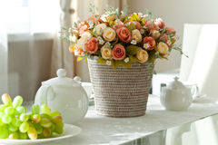 Bunch of roses on dining table Stock Photos