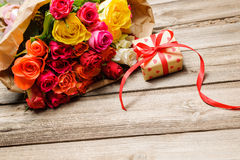 Bunch of roses with a gift box Royalty Free Stock Image
