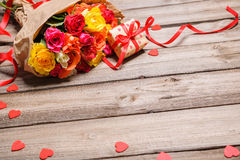 Bunch of roses with a gift box Stock Photo