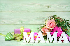 Bunch of roses with a gift box and word Mama Stock Photo