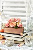 Bunch of roses lying on old books Royalty Free Stock Image