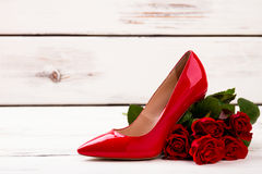 Bunch of roses and shoe. Stock Images