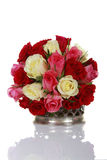 Bunch of roses in a silver vase. A bunch of red and white roses in a silver antique vase Royalty Free Stock Images