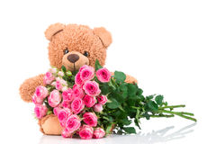 Bunch of roses and a teddy bear Royalty Free Stock Photos