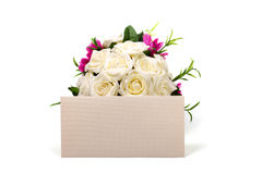 Bunch of roses and textured blank envelope Royalty Free Stock Image