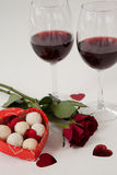 Bunch of roses, wine glasses and assorted chocolate box Stock Photo