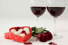 Bunch of roses, wine glasses and assorted chocolate box Royalty Free Stock Photos