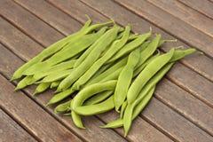 Bunch of runner beans. Runner beans on garden table Royalty Free Stock Images