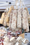 Bunch of salamis on the market. In Italy city Brescia Royalty Free Stock Images