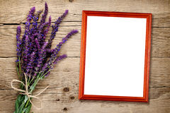 Bunch of salvia and empty photo frame Royalty Free Stock Photo