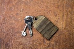 Bunch of scrached keys with empty wooden label royalty free stock photos