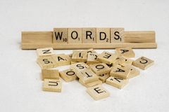 Words are made of letters. A bunch of scrambled game board pieces with, focusing on word Words Stock Images