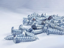 Bunch of screws. In macro in the white background Stock Photo