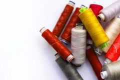 A bunch of sewing thread reels. A closeup photo of colorful sewing thread reels stock photo
