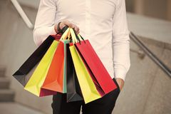 Bunch of shopping bags in male hands outdoor, close up. Shopping tips. Successful shopping expedition. What a waste. Buy. With list to not overspend and waste royalty free stock photography