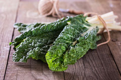Bunch of silverbeet on a rustic wooden background close up