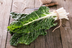 Bunch of silverbeet on a rustic wooden background Royalty Free Stock Images