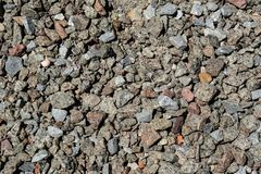 Bunch of a small crushed stones background. Bunch of a small crushed stones rocky background view at construction site royalty free stock images