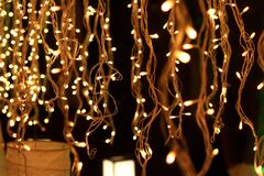 Bunch of small lights hanging on string
