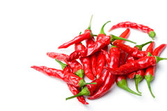 Bunch small red spicy hot chili peppers isolated Stock Images