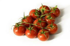 A bunch of small vine tomatoes isolated on white background - high angle view Royalty Free Stock Photos