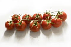 Small vine tomatoes isolated on white background - high angle view Stock Photography
