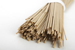 Bunch of soba noodles. Bunch of raw soba noodles laying over white background Stock Image