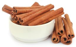 Bunch of some fresh aromatic cinnamon. In a bowl over white background stock photography
