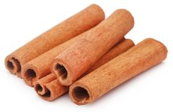 Bunch of some fresh aromatic cinnamon. Over white background stock photo