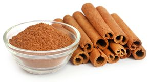 Cinnamon with powder spice. Bunch of some fresh aromatic cinnamon with powder spice Royalty Free Stock Photography