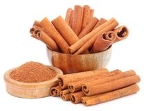 Bunch of some fresh aromatic cinnamon with powder spice. Over white background Stock Photography