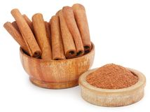 Cinnamon with powder spice. Bunch of some fresh aromatic cinnamon with powder spice Stock Photos