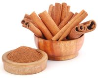 Fresh aromatic cinnamon with powder spice. Bunch of some fresh aromatic cinnamon with powder spice Royalty Free Stock Images