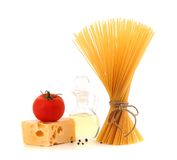 Bunch of spaghetti pasta, fresh tomatoes, cheese. Bottle of oil and pepper Stock Image