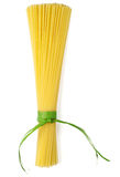 Bunch of spaghetti tied up with green ribbon Stock Photography