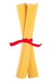 Bunch of spaghetti tied up with red ribbon Stock Image