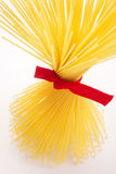 Bunch of spaghetti tied up with red ribbon Stock Photography