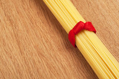 Bunch of spaghetti tied up with a red ribbon Stock Photos