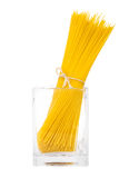 Bunch of spaghetti in transparent vase isolated on white backgro Stock Photos