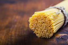 Bunch of spaghetti on wooden table Stock Photos