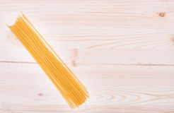 Bunch of spaghetti on wooden table Royalty Free Stock Image