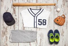 Bunch of sportswear and baseball equipment Stock Image