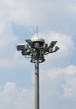 Bunch spot-light pole tower in blue sky Stock Images