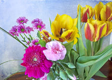 Bunch of spring flowers on grunge background Stock Image