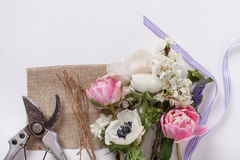 Bunch of spring flowers with implements Stock Images