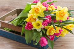 Bunch of spring flowers in wooden crate stock photography
