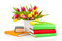 Bunch of spring tulips and books Stock Photos