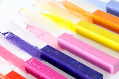 Bunch of square colorful pastel chalks and their pigments Royalty Free Stock Images